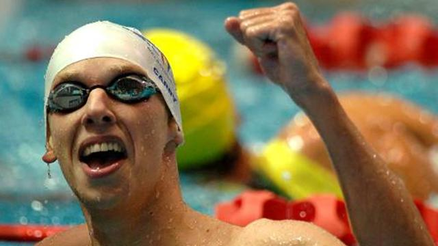 Olympic swim team gains seven