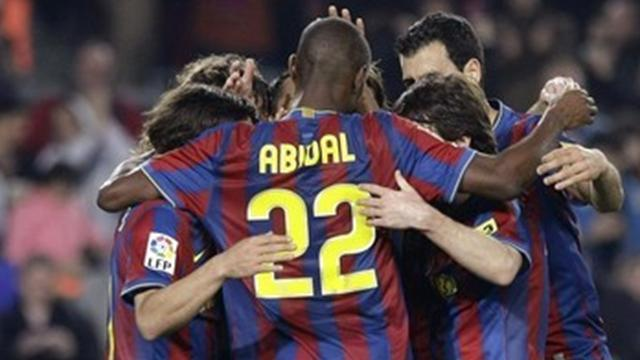 Round-up: Abidal takes Barca through