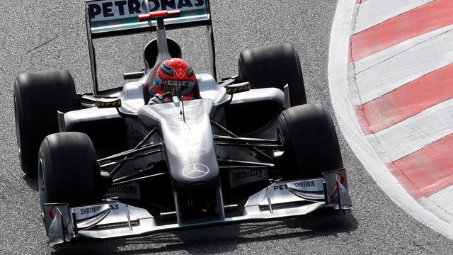 Schumacher third as Red Bull lead