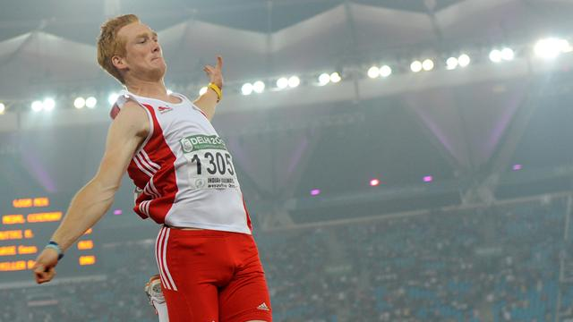 Rutherford leaps to silver
