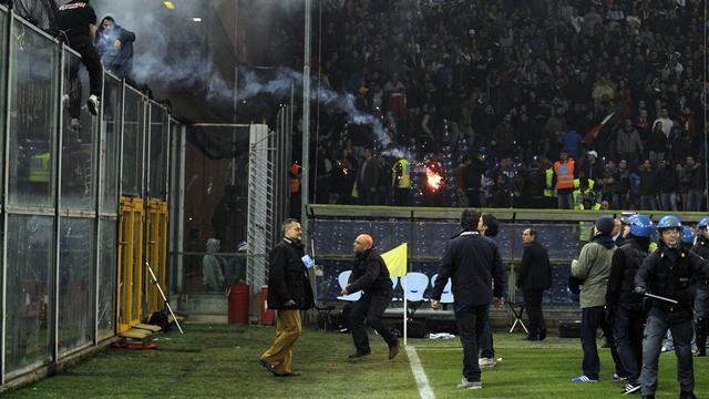 Italy match abandoned after riot