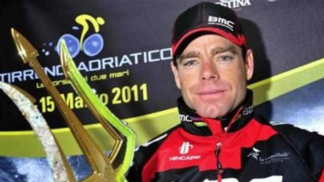 Australia's Cadel Evans poses with his trophy after winning the Tirreno Adriatico