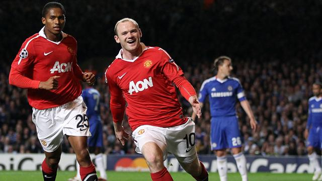 FOOTBALL Wayne Rooney and Antonio Valencia celebrate a Manchester United goal against Chelsea at Stamford Bridge in their Champions League quarter-final first leg.
