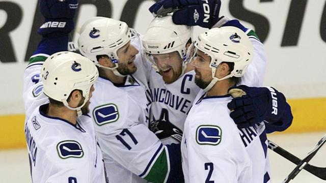 Canucks push Predators to brink