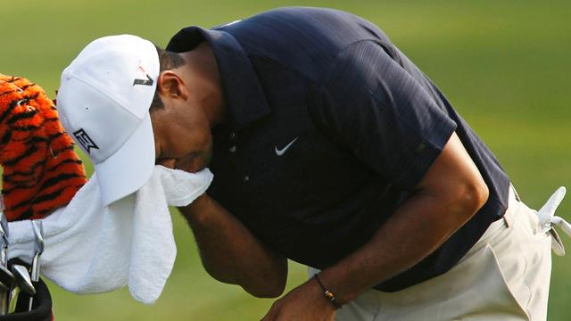 Woods quits Players - Golf