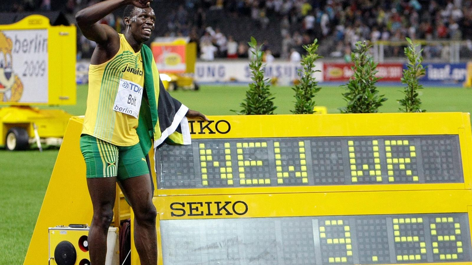 Usain Bolt of Jamaica celebrates winning the men's 100 meters final during the world athletics championships at the Olympic stadium in Berlin, August 16, 2009.