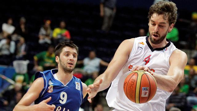 Spain crush Serbs to qualify
