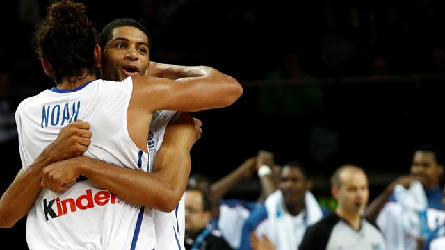 France down Greece to reach semis