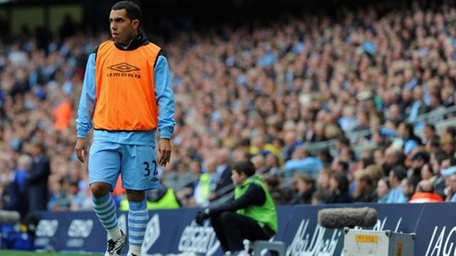 Carlos Tevez of Manchester City looks on from the sidelines during the Barclays Premier League match between Manchester City and Everton at the Etihad Stadium on September 24, 2011 in Manchester, England
