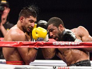 Khan cries robbery as Peterson takes titles