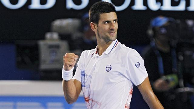 Djokovic overcomes adversity to reach semi