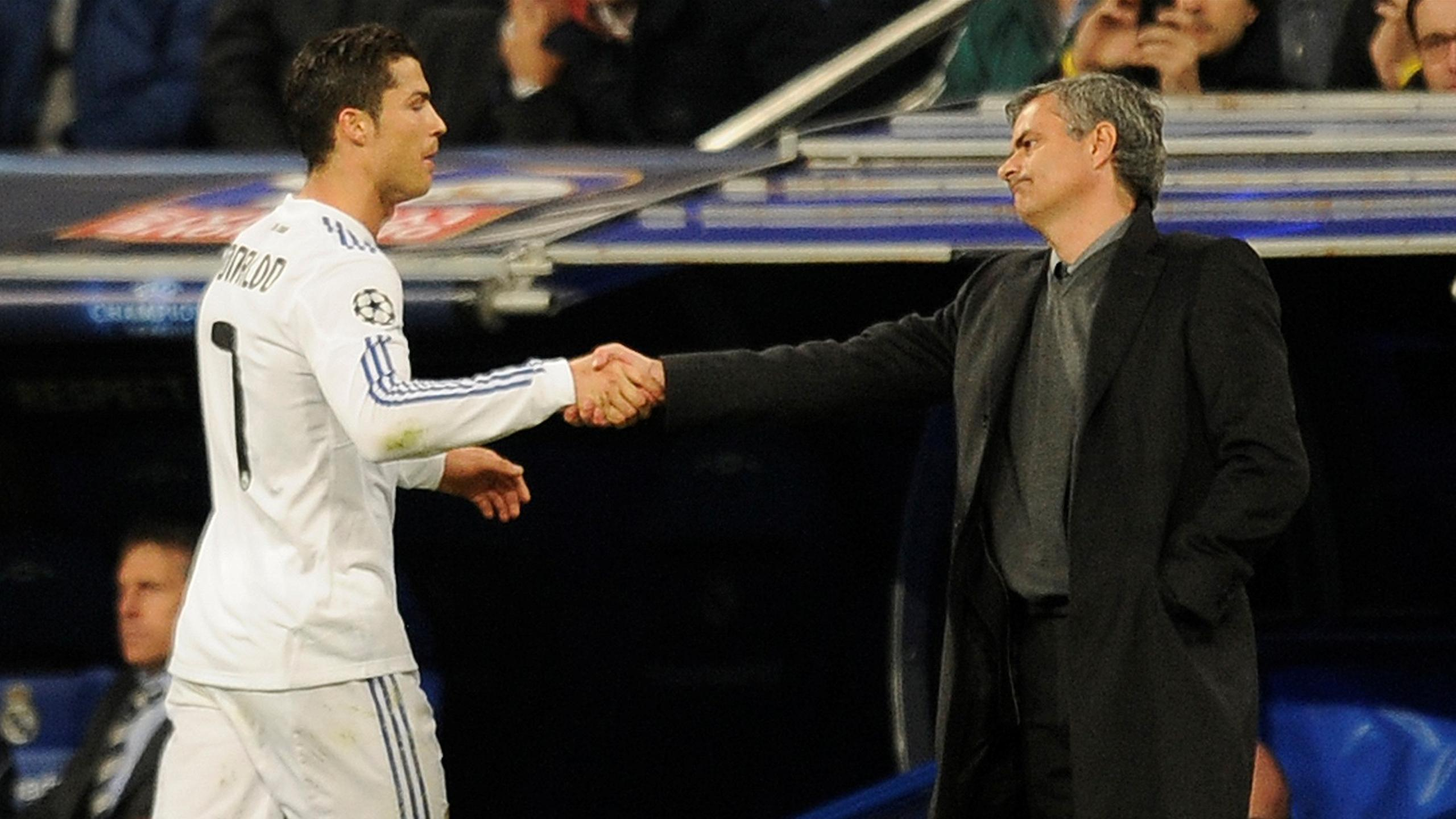 Real Madrid's Portuguese coach Jose Mourinho (R) shakes hands with Real Madrid's Portuguese forward Cristiano Ronaldo (L) during a Champions League football Real Madrid vs Olympique Lyonnais in Santiago Bernabeu Stadium in Madrid on March 16, 2011.