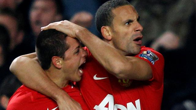 Manchester United's Javier Hernandez (L) and Rio Ferdinand celebrate after scoring a goal during their English Premier League soccer match against Chelsea at Stamford Bridge in London February 5, 2012.