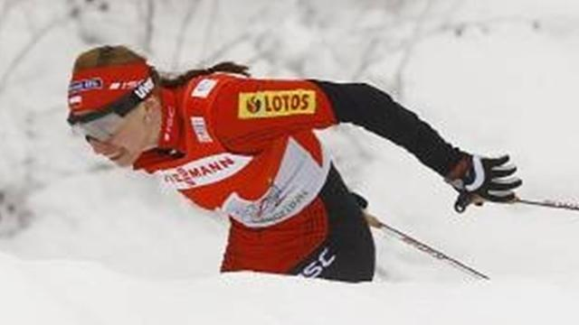 Kowalczyk wins to take World Cup lead