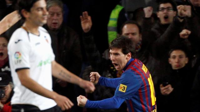 Messi scores four as Barca beat Valencia