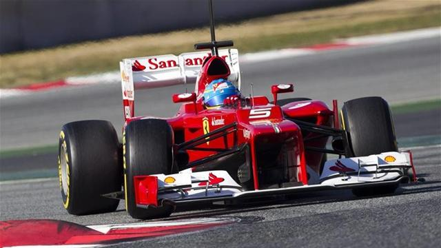 Alonso puts Ferrari top in Barcelona