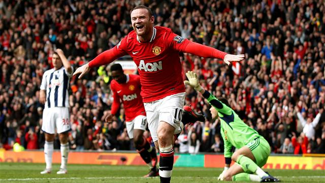 Rooney brace sends Man United top