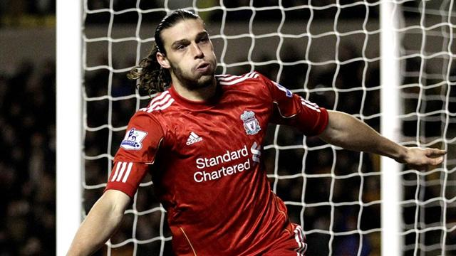 Carroll gives 10-man Liverpool dramatic win