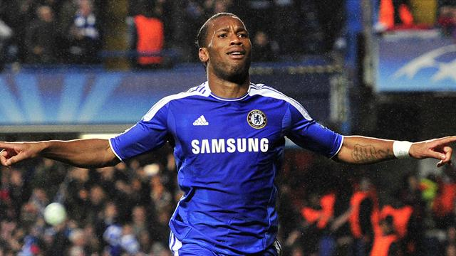 Chelsea's Ivorian forward Didier Drogba celebrates after scoring a goal during the UEFA Champions League semi-final first leg football match between Chelsea and Barcelona at Stamford Bridge in London on April 18, 2012