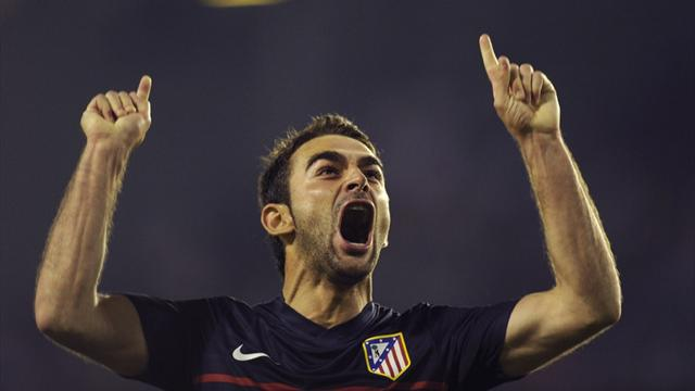 Adrian stunner sees Atletico through