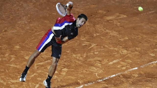 Djokovic sees off Tomic in Rome