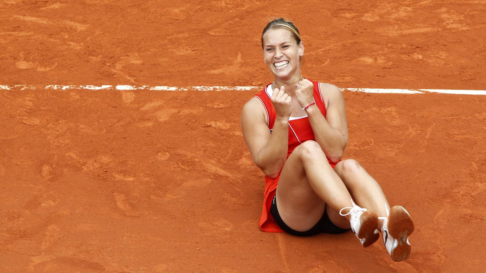Dominika Cibulkova of Slovakia reacts after winning her match against Victoria Azarenka of Belarus during the French Open tennis tournament at the Roland Garros stadium in Paris