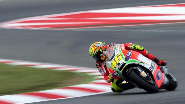 Rossi leads wet practice - Motorcycling