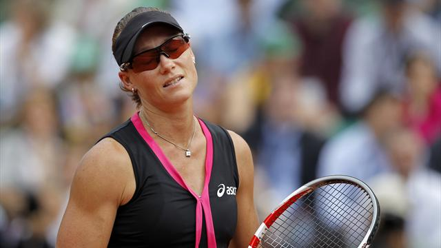 Flipkens stuns Stosur as top seeds crash