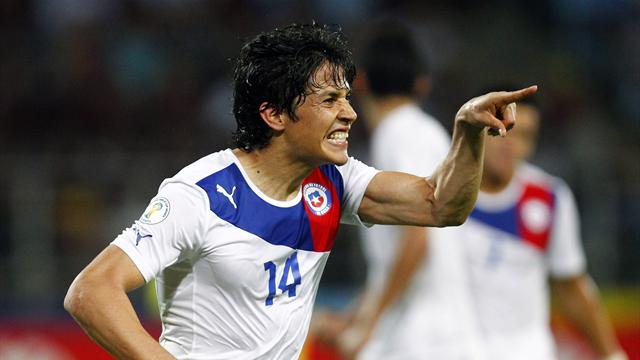 Chile go top with late win