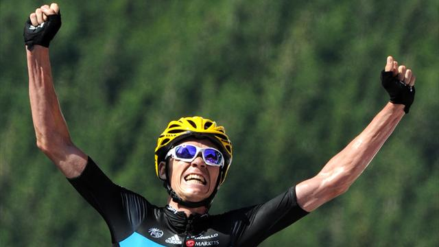 Froome wins as Wiggins takes yellow