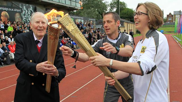 Bannister carries torch at site of famous mile