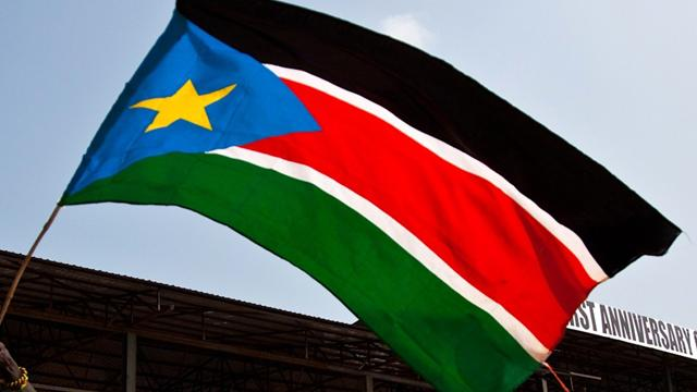 South Sudanese runner under Olympic flag