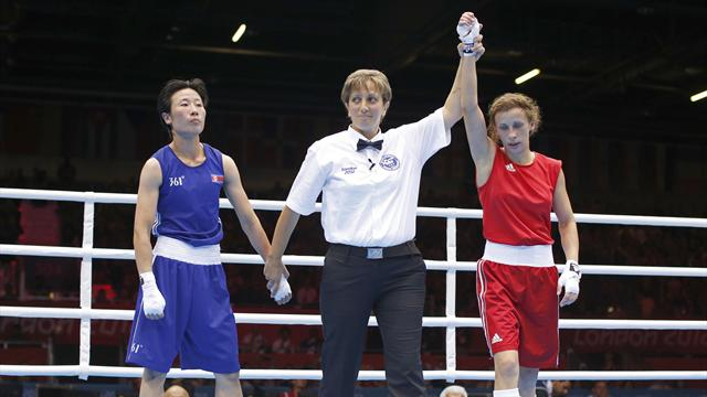 Russian wins first women's Olympic boxing bout