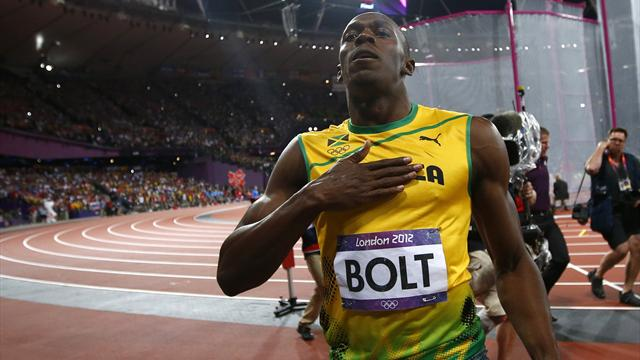Bolt retains 100m title in Olympic record time