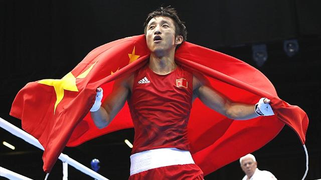 Zou claims Olympic gold in light-flyweight