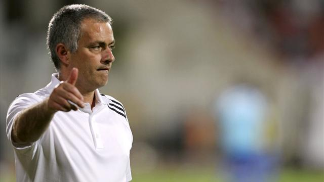 Real Madrid coach Jose Mourinho gestures during their friendly soccer match against Kuwait's national team in Kuwait City (Reuters)