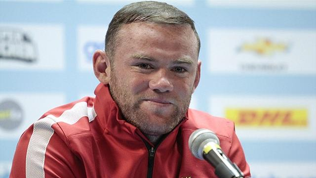Rooney: I'll become a midfielder