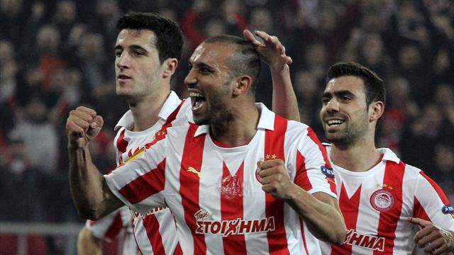 Olympiakos extend winning start in Greece