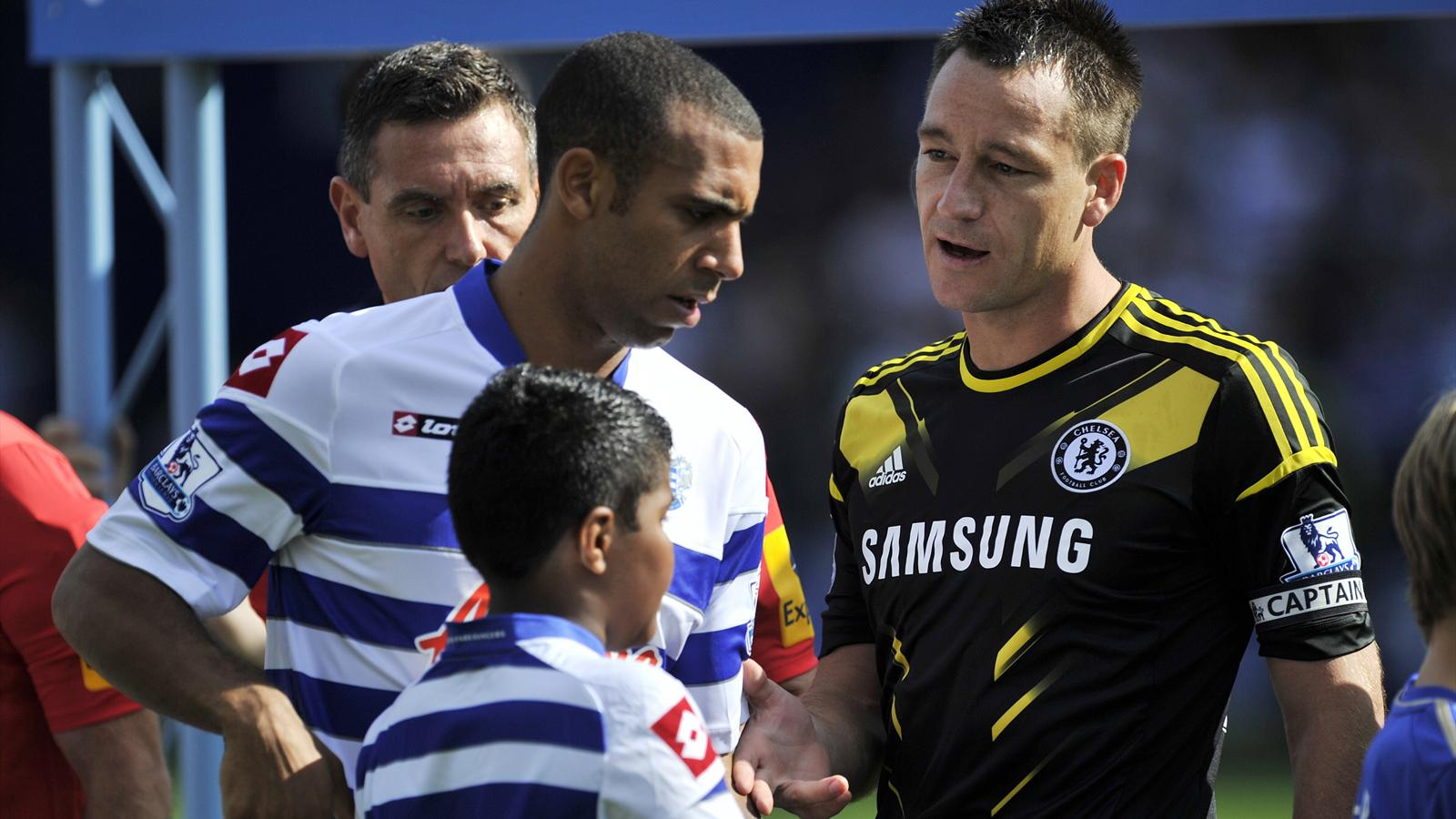 Queens Park Rangers' English defender Anton Ferdinand (L) avoids shaking hands with Chelsea's English defender John Terry (R) before the English Premier League football match between Queens Park Rangers and Chelsea at Loftus Road in London (AFP)