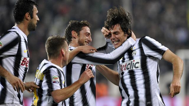 Juventus' Paolo De Ceglie (R) celebrates with team-mates after scoring against Chievo i