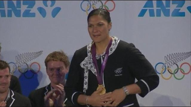 Adams receives gold - Athletics - Olympic Games