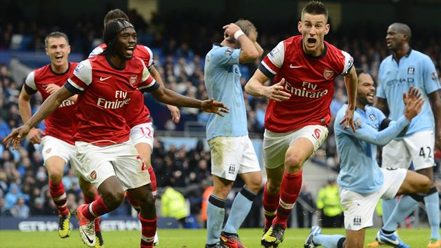 Koscielny earns Arsenal draw at Manchester City