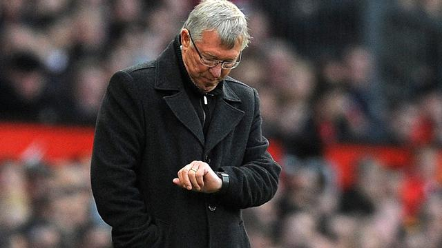 Manchester United manager Alex Ferguson checks his watch during the English Premier League football match between Manchester United and Tottenham Hotspur at Old Trafford in Manchester, north-west England on September 29, 2012 (AFP)