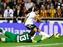 Valencia inflict first defeat on Atletico