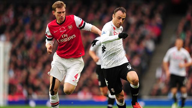 Fulham's Dimitar Berbatov (right) and Arsenal's Per Mertesacker (left) battle for the ball