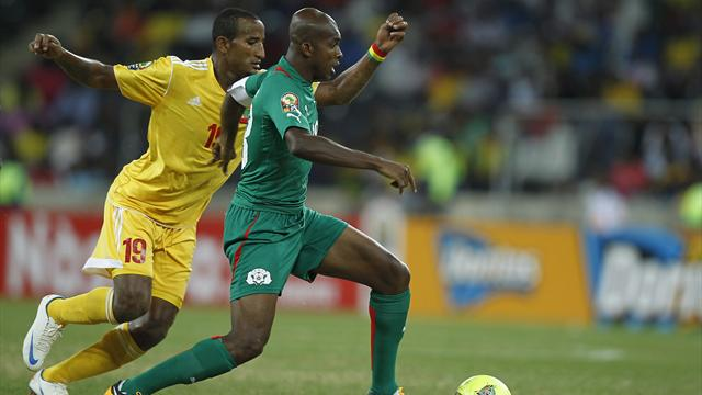 Burkina Faso's Kabore is challenged by Ethiopia's Girma during their AFCON 2013 Group C match in Nelspruit