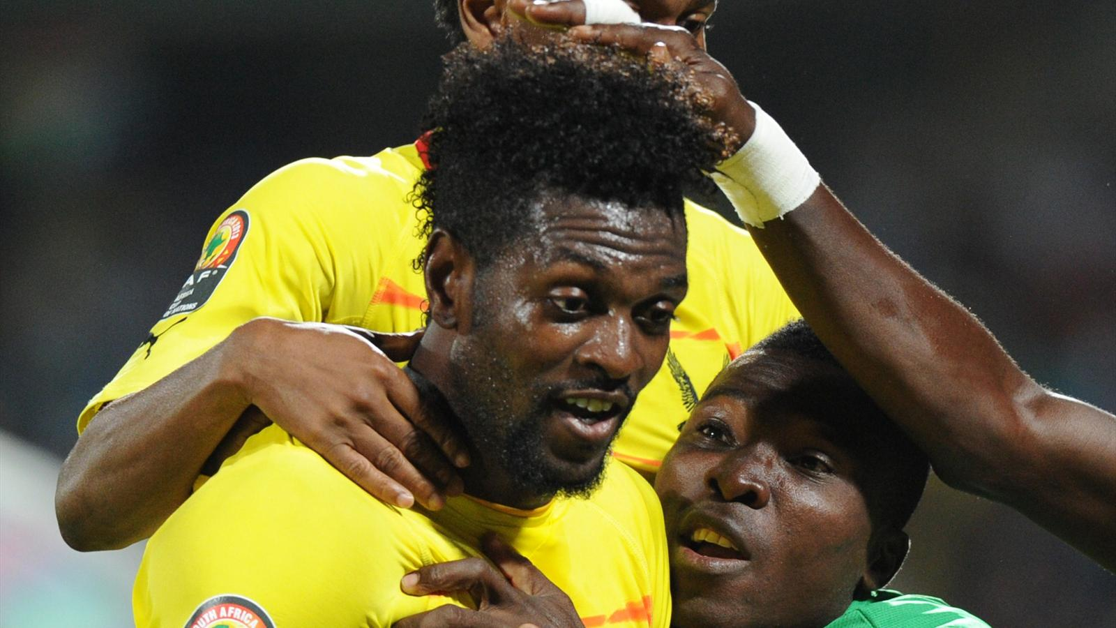 Togo's forward Emmanuel Adebayor (L) celebrates with teammates after scoring during the 2013 African Cup of Nations match Algeria vs Togo at Royal Bafokeng stadium in Rustenburg