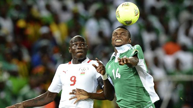 SOUTH AFRICA, Nelspruit : Nigeria's defender Godfrey Oboabona (R) vies with Burkina Faso's Moumouni Dagano during the Africa Cup of Nations 2013 Group C football match Nigeria vs Burkina Faso at Mbombela Stadium in Nelspruit