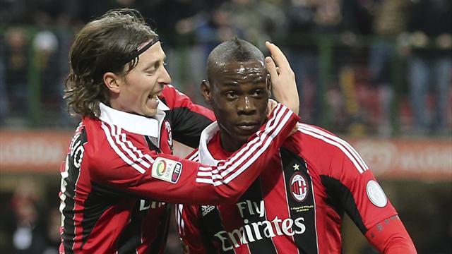 Balotelli strikes twice to lead Milan to win