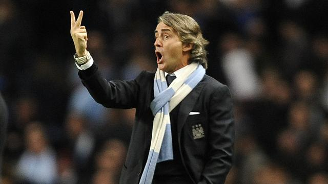 Mancini rants at linesman and Aguero